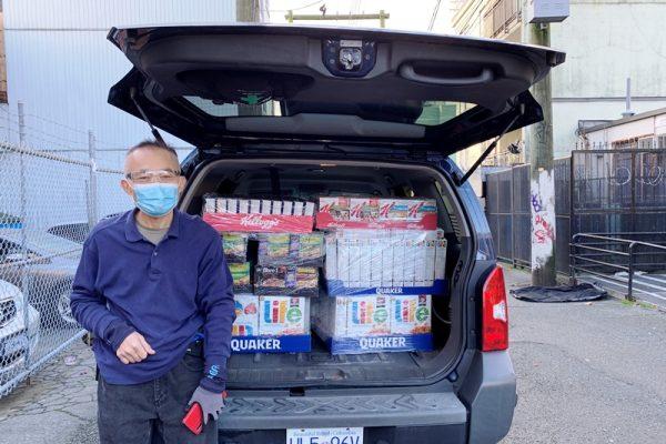 Lotus Light Volunteer Helps Loading Donation
